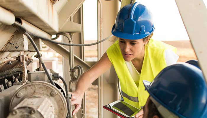 Technician with hard hat and ipad